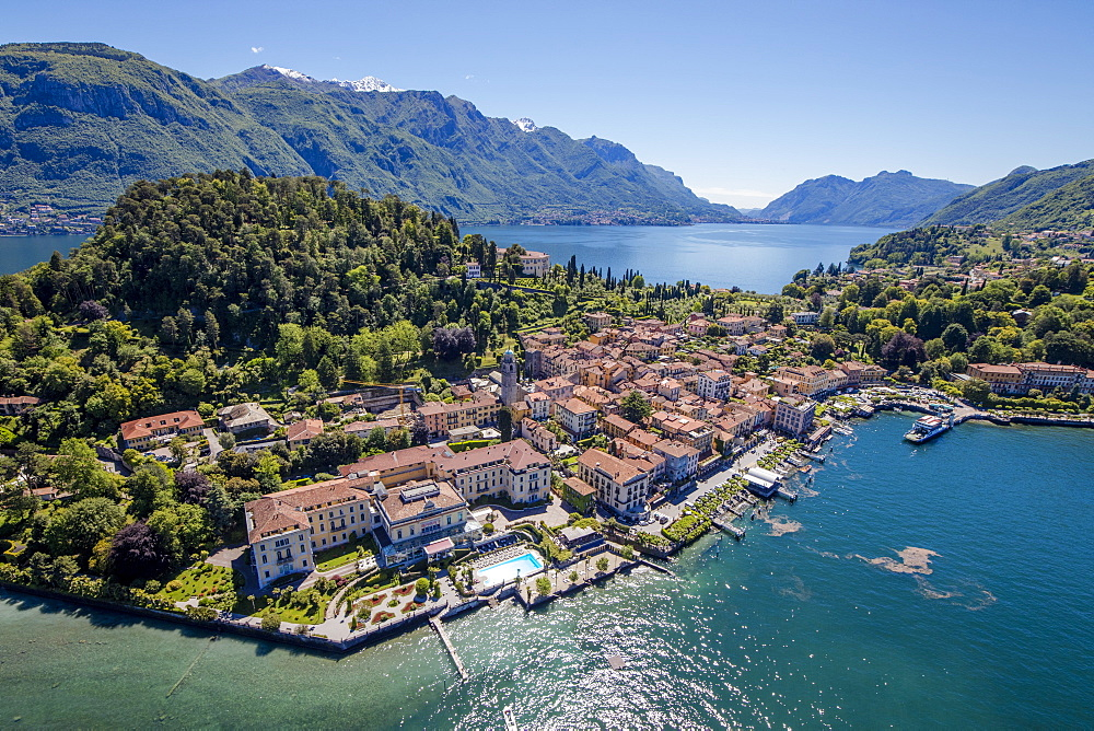 Aerial view of the turquoise waters of Lake Como and green headland that frames the village of Bellagio, Lombardy, Italy, Europe