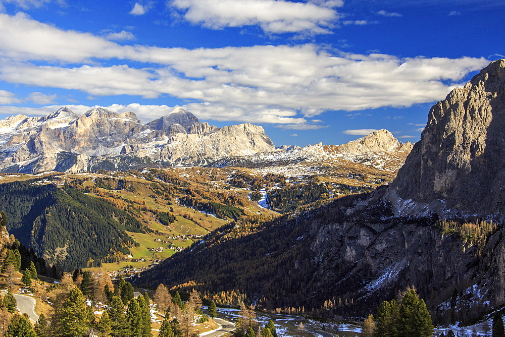The colorful woods frame the landscape and the high peaks in autumn Gardena Pass, Trentino-Alto Adige, Italy, Europe