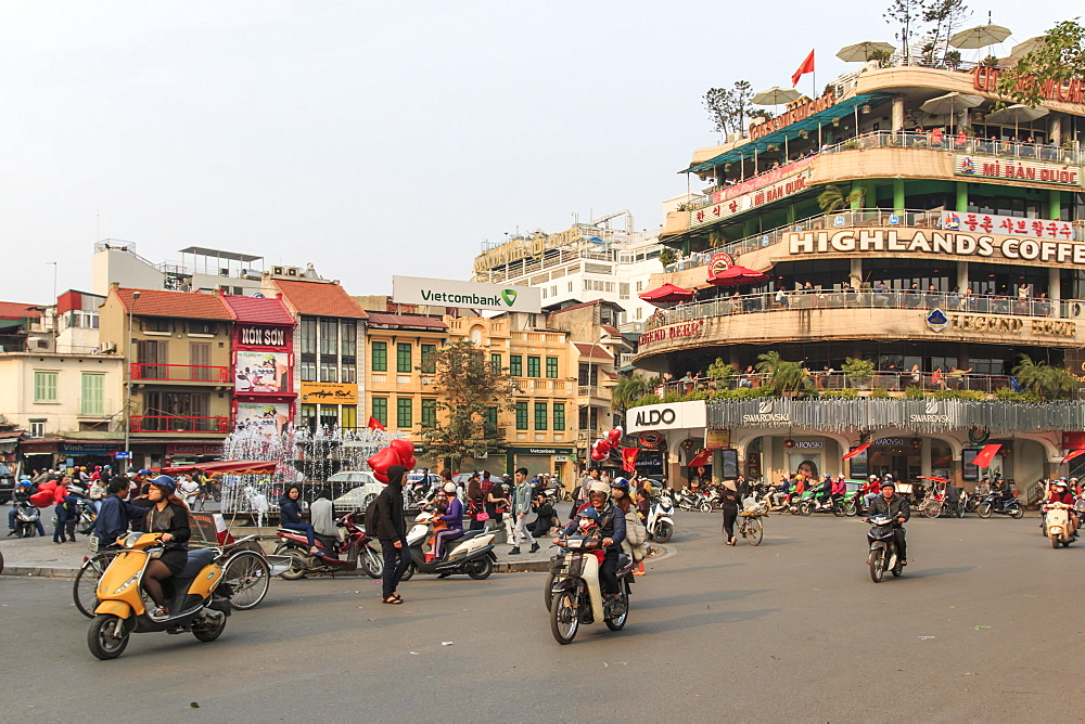 Traffic in the city center of Hanoi nearby the Hoan Kiem lake, Hanoi, Vietnam, Indochina, Southeast Asia, Asia