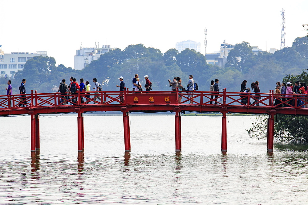 People walking on the Huc Bridge over the Hoan Kiem Lake, Hanoi, Vietnam, Indochina, Southeast Asia, Asia