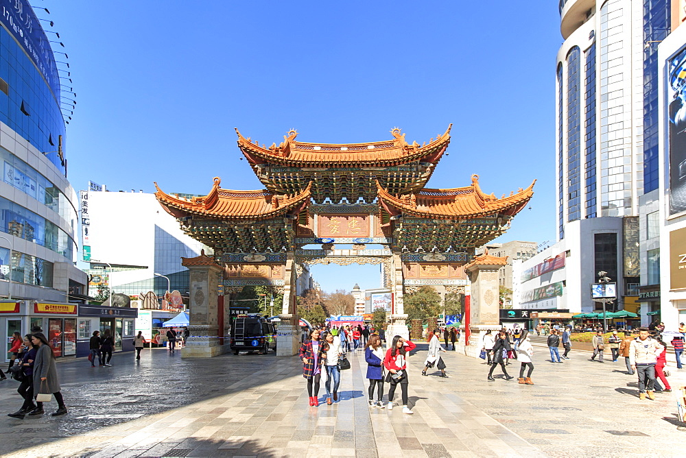 Tourists walking in the city center of Kunming in China