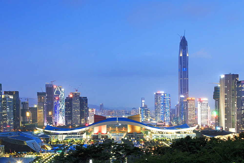 Shenzhen cityscape at dusk with the Civic Center and the Ping An IFC on foreground, China