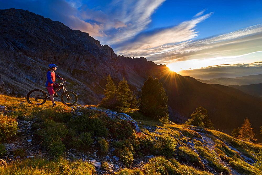 Mountain bikers at sunset, Carezza, Latemar, Trentino-AltoAdige, Dolomites, Italy, Europe