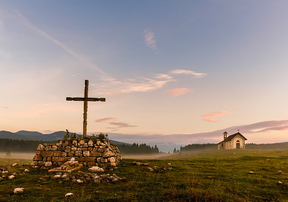 Wooden Cross, Saint Lorenzo church in the mist, Plains of Marcesina, Altopiano of Asiago, Veneto, Italy, Europe