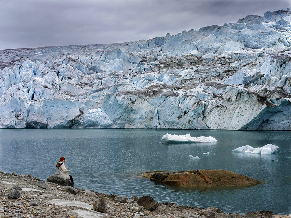 Tourists near the glaciers in the Qalerallit Imaa Fjord in southern greenland. America, North America, Greenland, Denmark - 746-88012