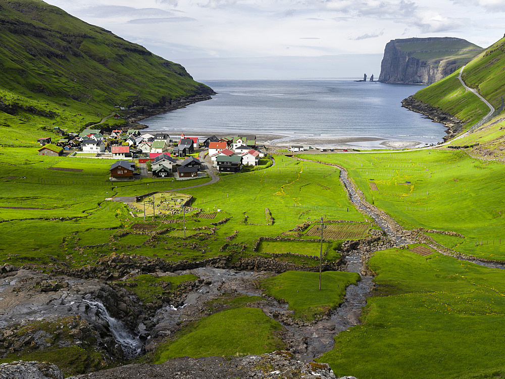 Village Tjornuvik. In the background the island Eysturoy with the iconic sea stacks Risin and Kellingin, North Atlantic.  Europe, Northern Europe, Denmark, Faroe Islands