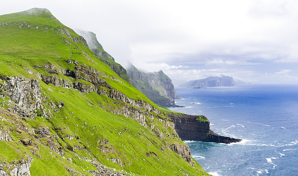 The island Mykines,in the background the island Vagar, part of the Faroe Islands in the North Atlantic, Denmark, Northern Europe - 746-88112