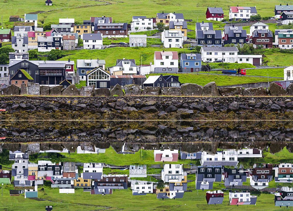 Small town Midvagur on the island of  Vagar, part of the Faroe Islands.   Europe, Northern Europe, Denmark, Faroe Islands