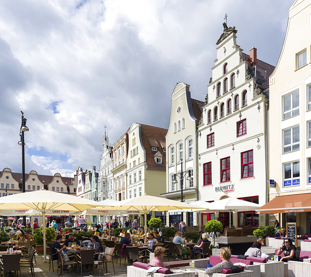 Traditional houses buildt in the middle ages with cafe and restaurant at the  Neuer Markt (new market).  The hanseatic city of Rostock at the coast of the german baltic sea.  Europe,Germany, Mecklenburg-Western Pomerania, June