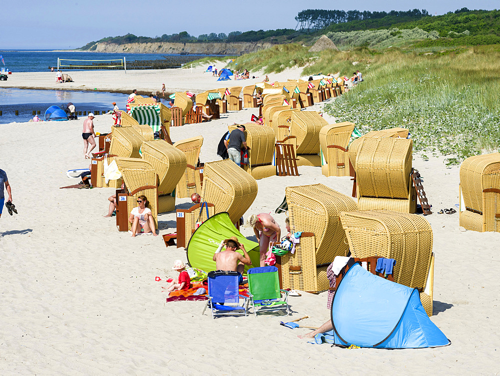 Beach at the Baltic Sea with typical Strandkoerben (beach chairs). Wustrow on Fischland Peninsula. Europe, Germany, West-Pomerania, June
