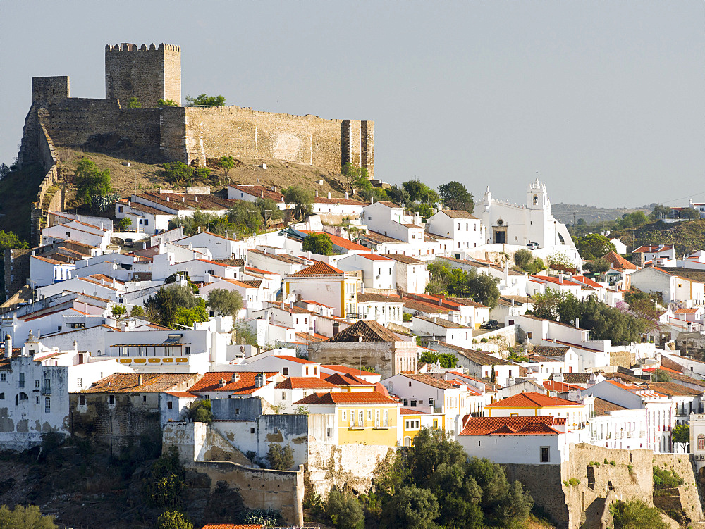 Mertola on the banks of Rio Guadiana in the  Alentejo.  Europe, Southern Europe, Portugal, March