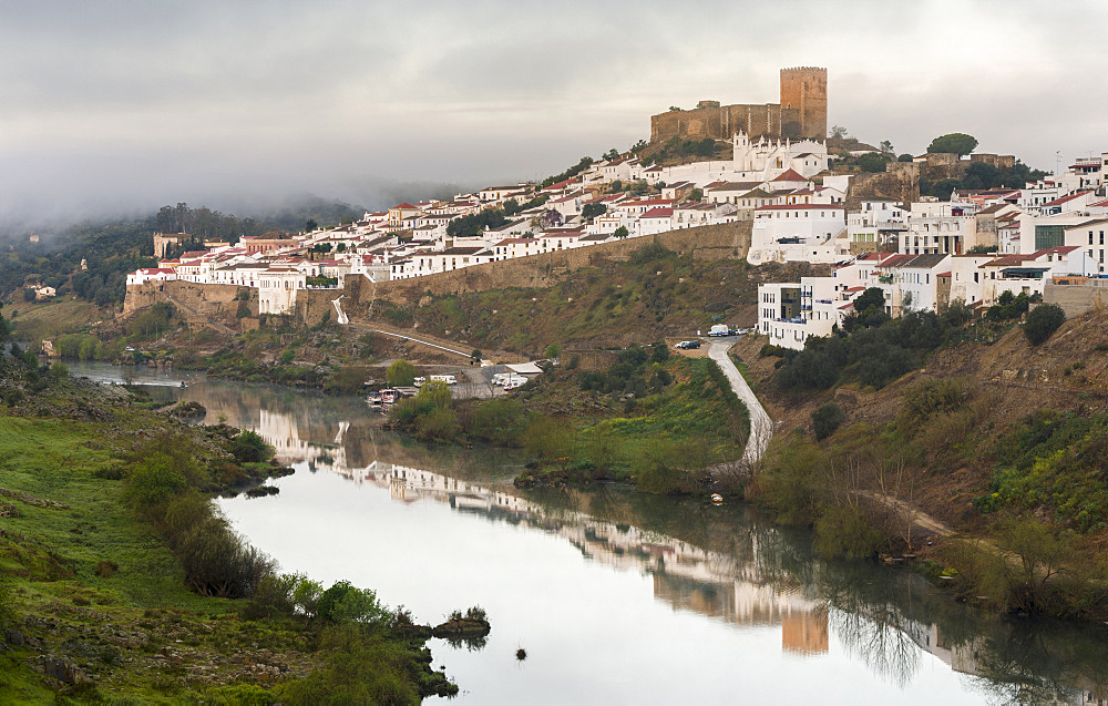 Mertola on the banks of Rio Guadiana in the  Alentejo.  Europe, Southern Europe, Portugal, March - 746-88190