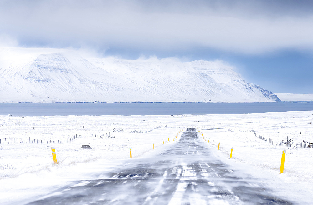 Landscape in Skagafjoerdur during winter. view of a snowed in country road with the fjord in the background  europe, northern europe, iceland,  March