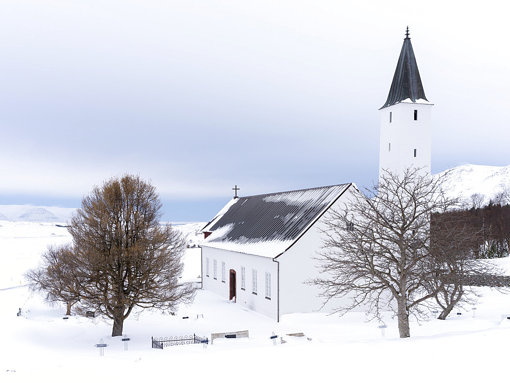 The church of Holar during winter. Holar is a famous archaeological site and is home to the Holar University Collage focusing on agriculture, horse breeding and tourism. europe, northern europe, iceland,  March