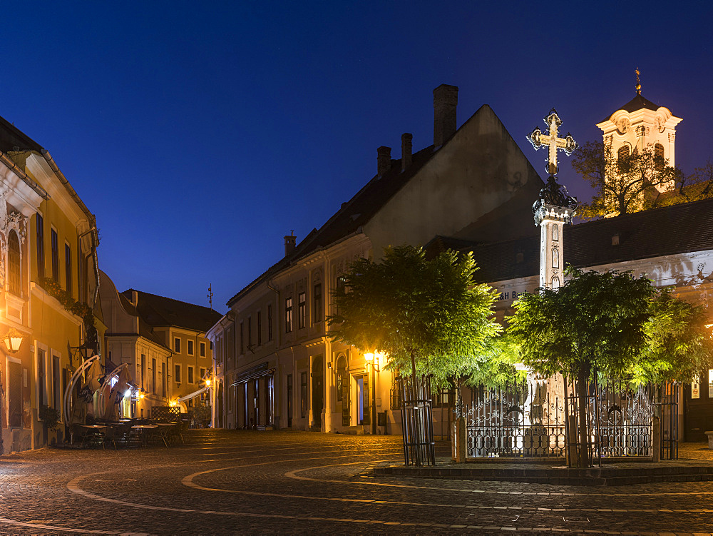 Szentendre near Budapest, a historic small town on the banks of the Danube. Dusk at Foe Ter (mains square) in  the old town with the church of John the Baptist.  Europe, Eastern Europe, Hungary, October