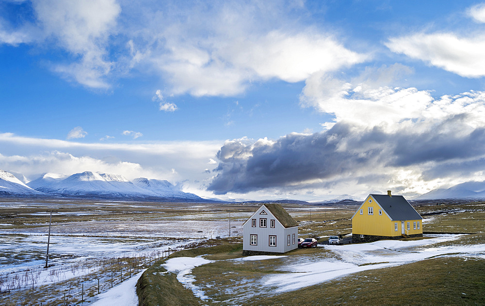 Contemporary Houses, one roof made of traditional peat and turf, in Skagafjoerdur during Winter. europe, northern europe, iceland,  February