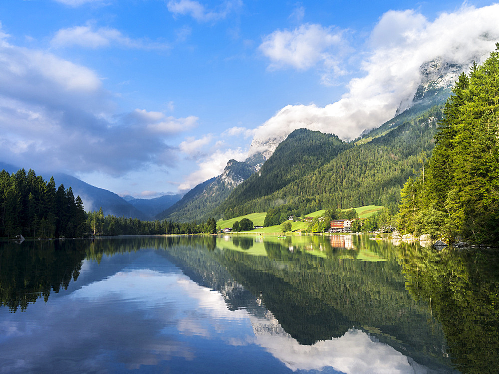 The romantic lake Hintersee , at morning with Reiter Alpe Mountain chain in the NP Berchtesgaden. Europe, Central Europe, Germany, Bavaria, July