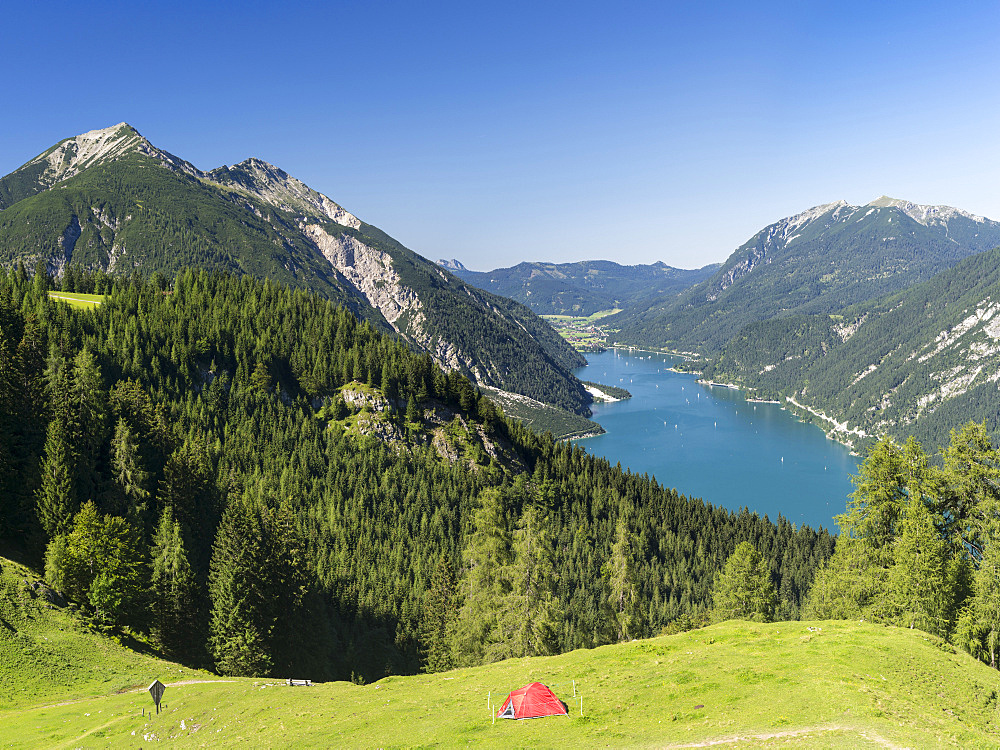 Lake Achensee in Tyrol, Austria.  This mountain lake seperates the Karwendel mountain ranges from the Brandenberger Alps with the Rofan mountains next to the lake. Left the Karwendel Mountains right the Rofan Mountains.  Europe, Central Europe, Austria, Tyrol, August
