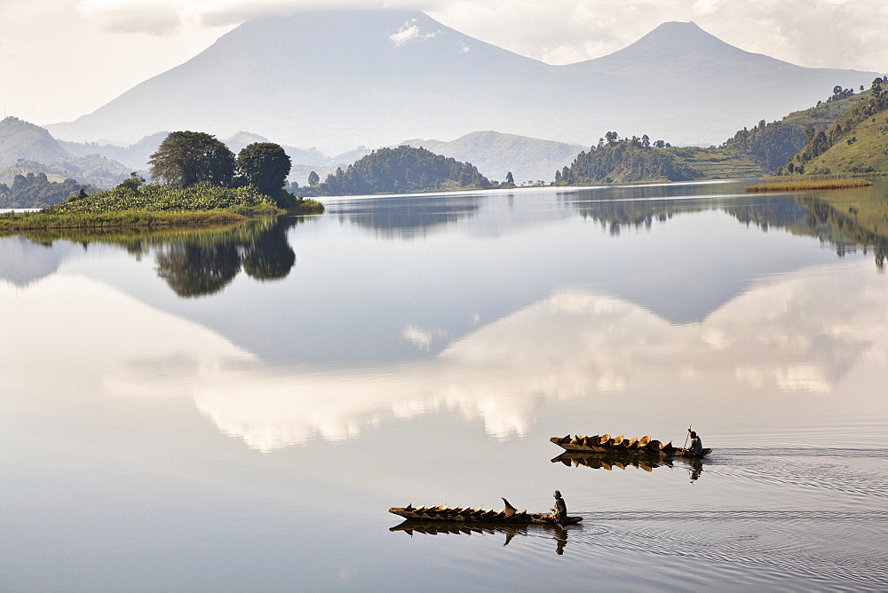 Lake Mutanda near Kisoro with the Virunga Vulcanoes as reflection in the lake, Africa, East Africa, Uganda, Kigezi, Kisoro