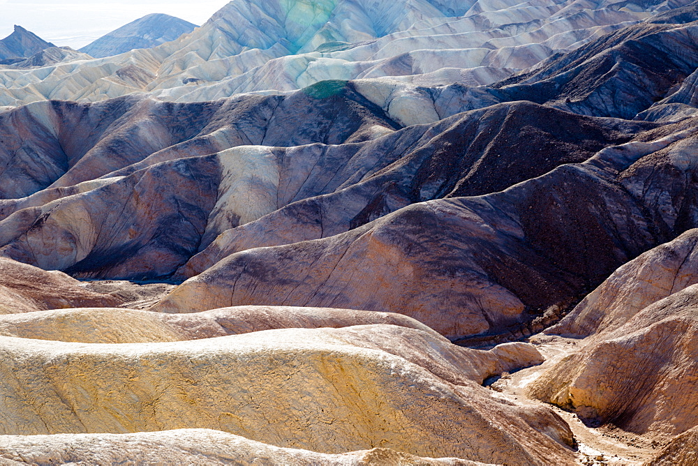 USA, California, Death Valley is a desert valley located in Eastern California. It is the lowest, driest, and hottest area in North America. Zabriskie Point. - 746-88519