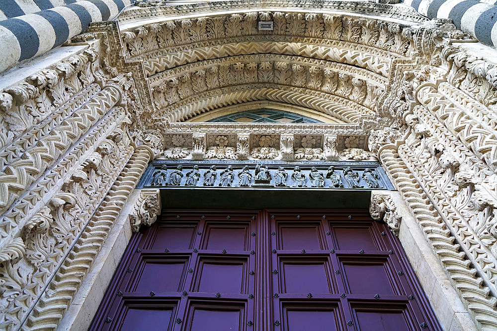 Side door, Cathedral Basilica of Santa Maria Assunta is the main Catholic place of worship in Orvieto, and a masterpiece of Gothic architecture in Central Italy, Umbria, Italy, Europe