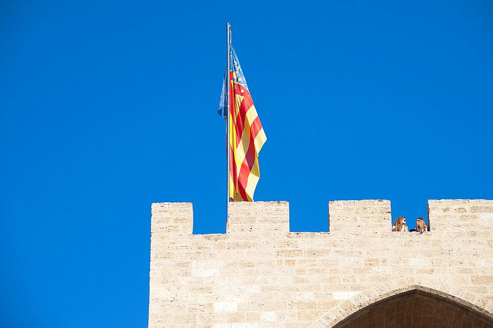 Flag And Tourist, Porta de Serrans, Plaça dels Furs, Valencia, Spain, Europe