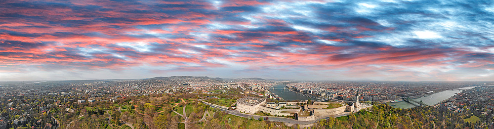 Panoramic aerial view of Budapest Citadel and city skyline at dusk, Hungary.