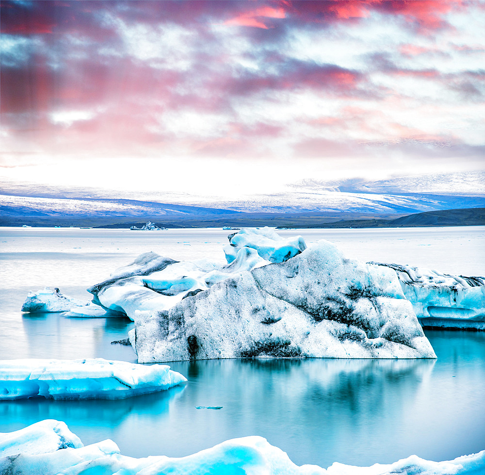 Jokulsarlon lake with icebergs at night, Iceland. Long exposure view at sunset