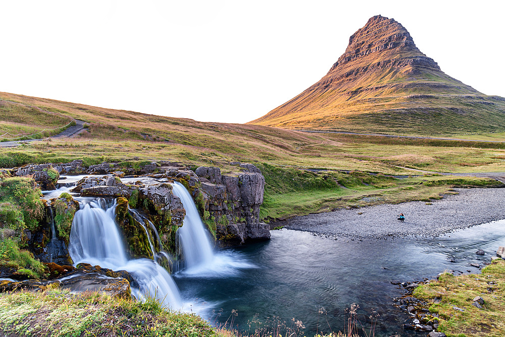 Kirkjufell Mountain and Waterfalls, Snaefellnes Peninsula, Iceland. Long exposure with moving water in summer season