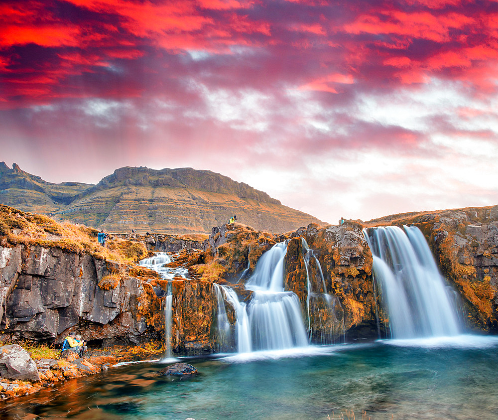 Famous travel location in Iceland. Kirkjufell Waterfalls at sunset, long exposure at sunset