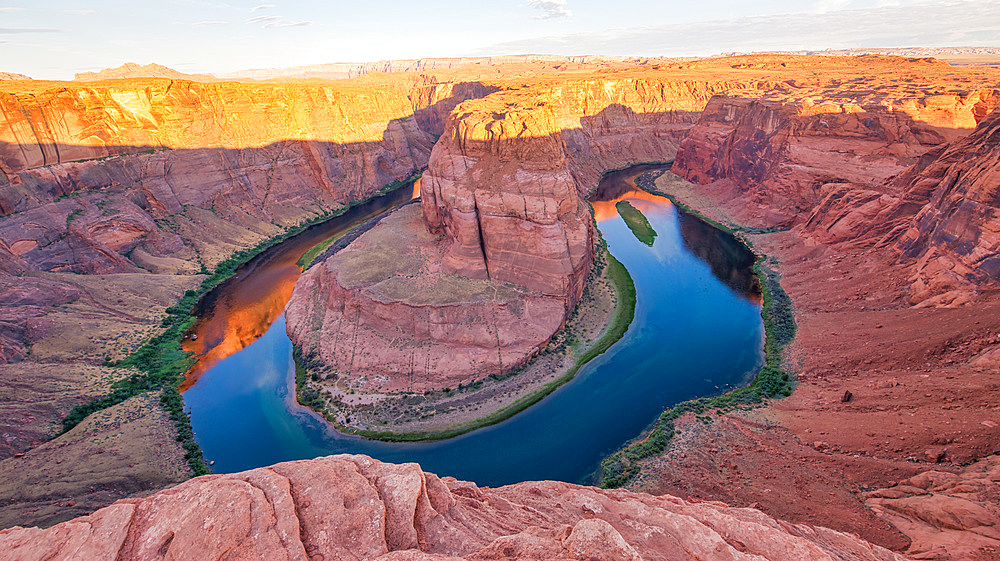 Dawn at Horseshoe Bend. Sunrise colors with Rocks and Colorado River.