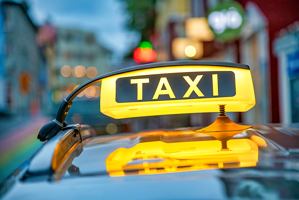 Taxi cab yellow sign in Reykjavik, Iceland.