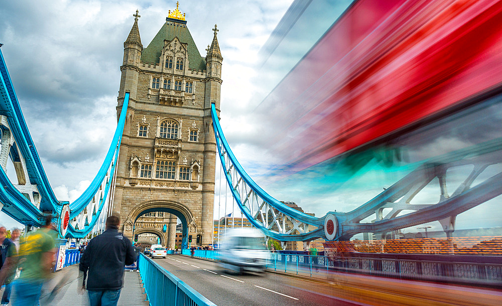 Blurred traffic under Tower Bridge, London.