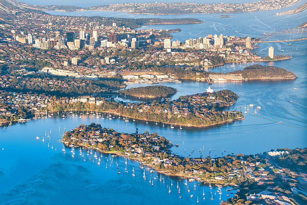 Aerial view of Sydney from an aircraft window.