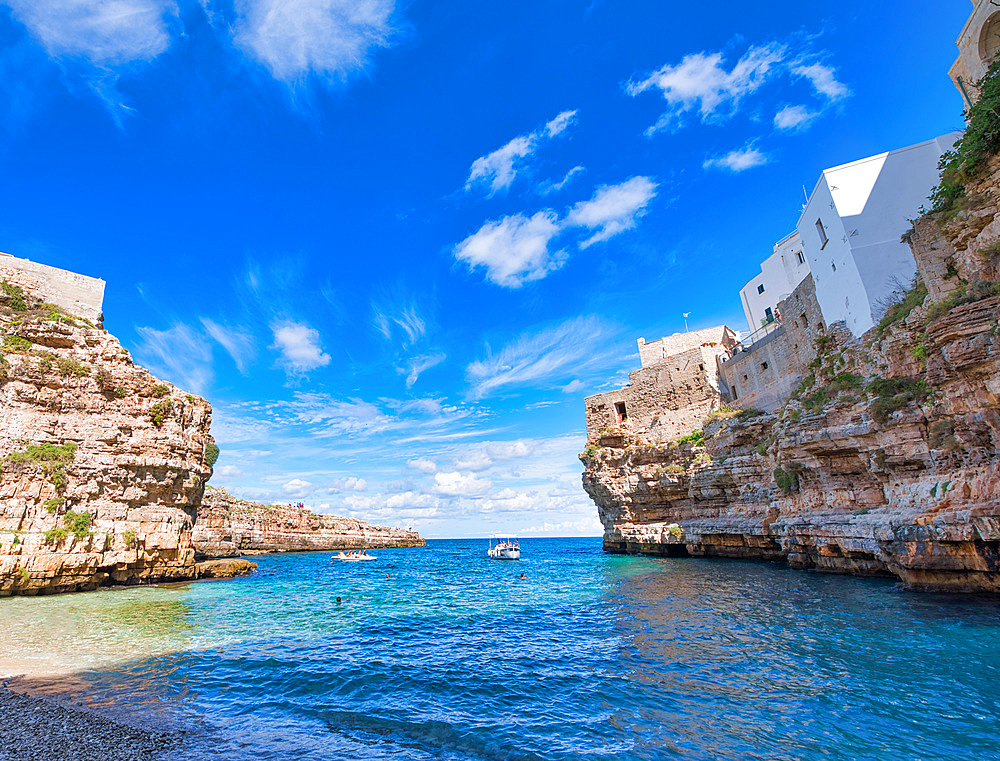 Amazing coastline of Polignano a Mare, Italy. Beach and beautiful summer sky.