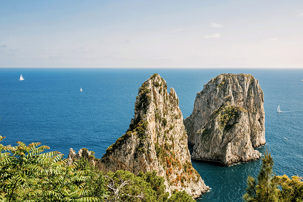 View at sea and Faraglioni rocks in the sunlight, Capri, Italy, Europe
