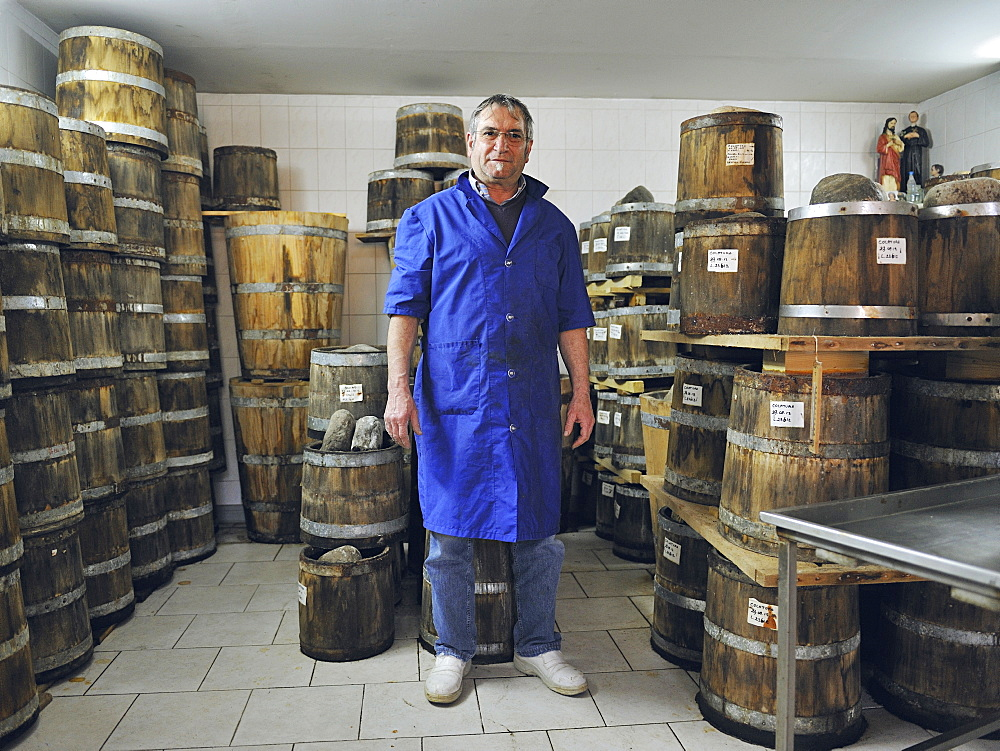 Portrait of Battista, fisherman and owner of the company Delfino which produces oil and salted anchovies, tuna and the famous Anchovy sauce called Colatura, Cetara, Amalfi Coast, Campania, Italy.
