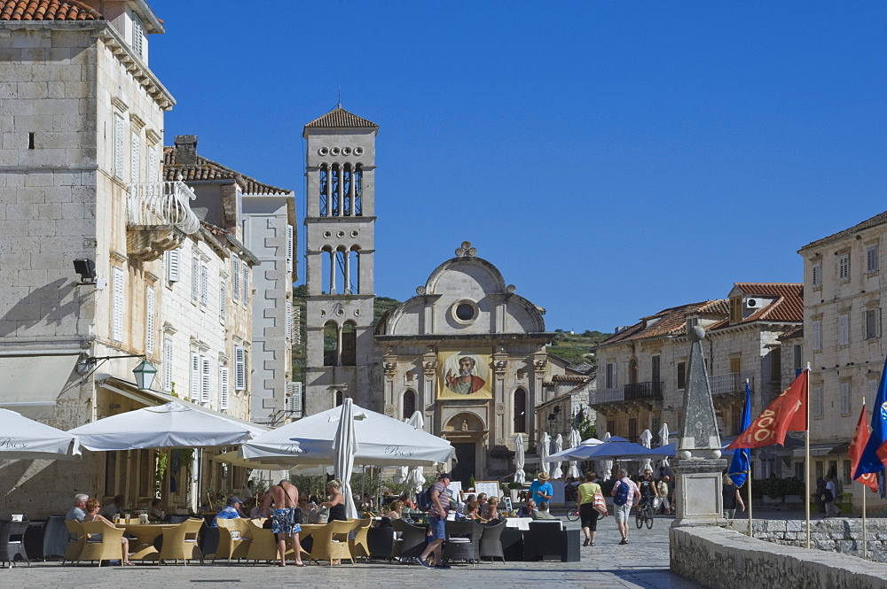 Cafes in the main square with St. Stephen's Cathedral in the medieval city of Hvar, Island of Hvar, Dalmatia, Croatia, Europe