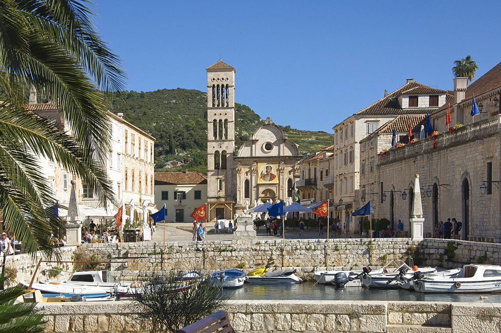 View from the old harbour across the main square to St. Stephens Cathedral, in the medieval city of Hvar, island of Hvar, Dalmatia, Croatia, Europe