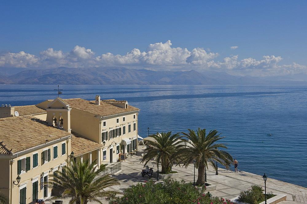Sea view over a sea side cafe from Corfu Town, Corfu Island, Ionian Islands, Greek Islands, Greece, Europe