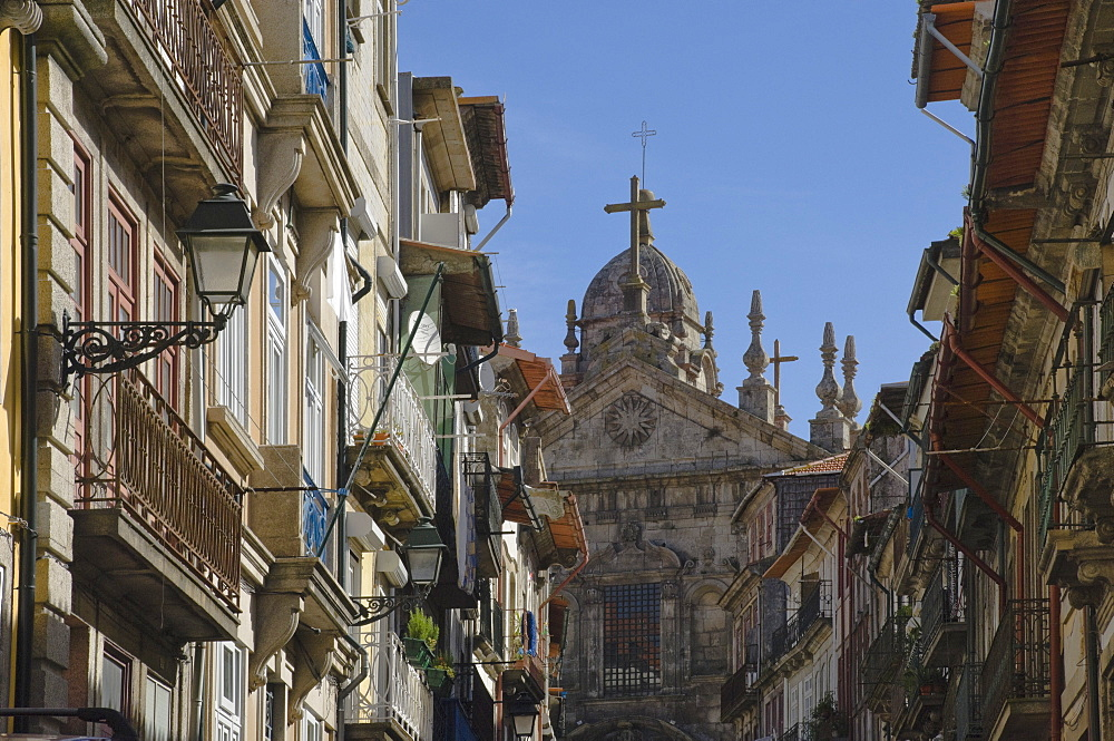 A church dominates a narrow street in the old town, Oporto, Portugal, Europe