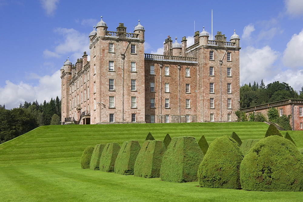 The 17th century Renaissance Drumlanrig Castle (Pink Palace) built by the 1st Duke of Queensberry William Douglass, viewed from the topiary garden, overlooking the Nith Valley, Dumfries and Galloway, Scotland, United Kingdom, Europe