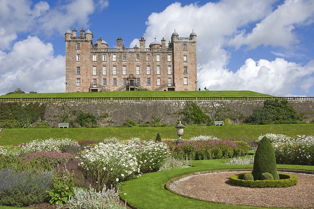 The 17th century Renaissance Drumlanrig Castle (Pink Palace) built by the 1st Duke of Queensberry, William Douglass, from the lower garden terrace, Dumfries and Galloway, Scotland, United Kingdom, Europe