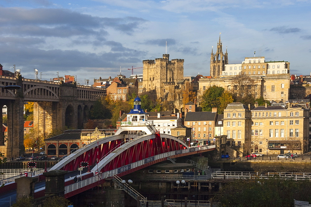 Swing Bridge crossing the River Tyne, 12th century Norman Castle Keep and the Lantern of the Cathedral Church of St. Nicholas, Newcastle upon Tyne, Tyne and Wear, England, United Kingdom, Europe