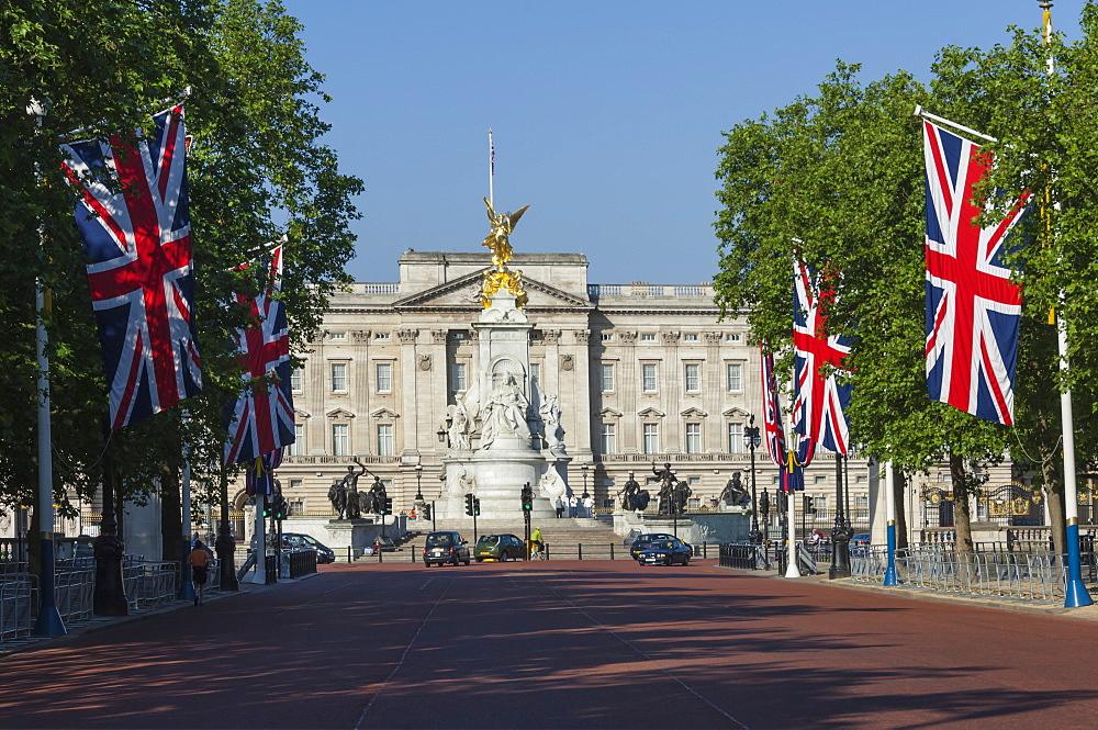 Buckingham Palace down the Mall with Union Jack flags, London, England, United Kingdom, Europe