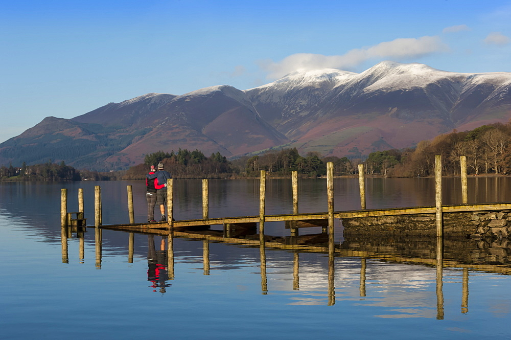 Ashness Boat Landing, two walkers enjoy the Skiddaw Range, Derwentwater, Keswick, Lake District National Park, Cumbria, England, United Kingdom, Europe