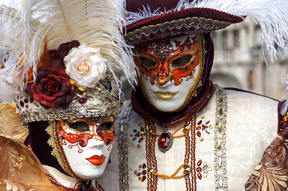 Lady and gentleman in red and white masks, Venice Carnival, Venice, Veneto, Italy, Europe
