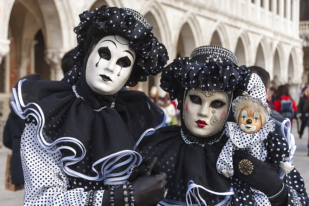 Couple in black and white with clown puppet, Venice Carnival, Venice, Veneto, Italy, Europe - 747-1670