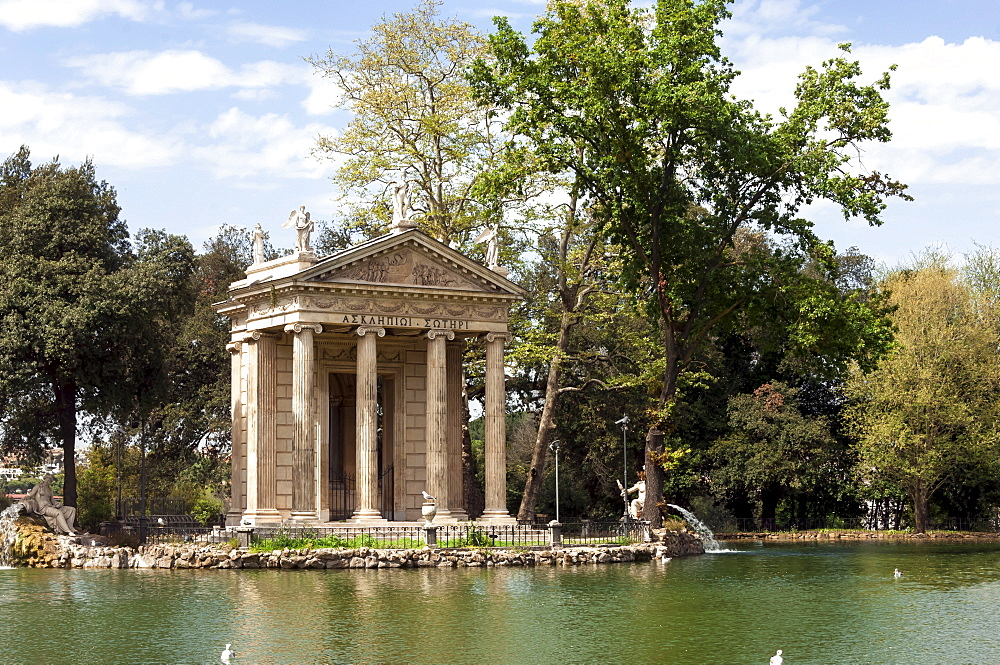 Ionic Temple of Aesculapius, God of Healing, designed by Antonio Asprucci, by an artificial lake in the Borghese Park, Rome, Lazio, Italy, Europe