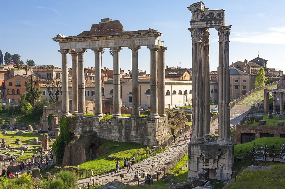 Ancient Roman Road traverses the columns and ruins in the Forum of Ancient Rome, UNESCO World Heritage Site, Rome, Lazio, Italy, Europe